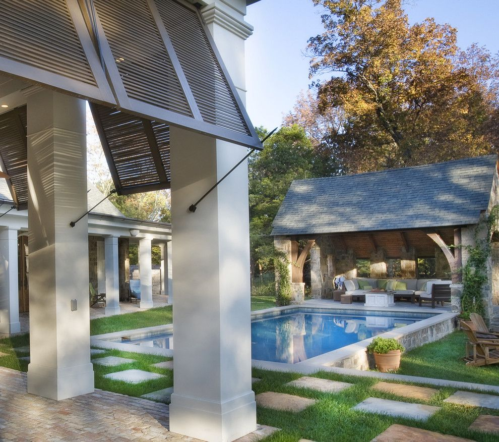 Hurricane Proof House for a Traditional Pool with a Pool House and Stone Residence 1 by Norris Architecture