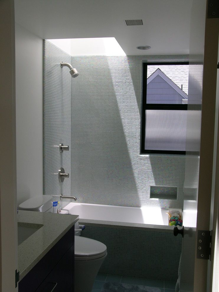 Icestone for a Contemporary Bathroom with a Skylight and Small Bathroom with Skylight by Cathy Schwabe Architecture