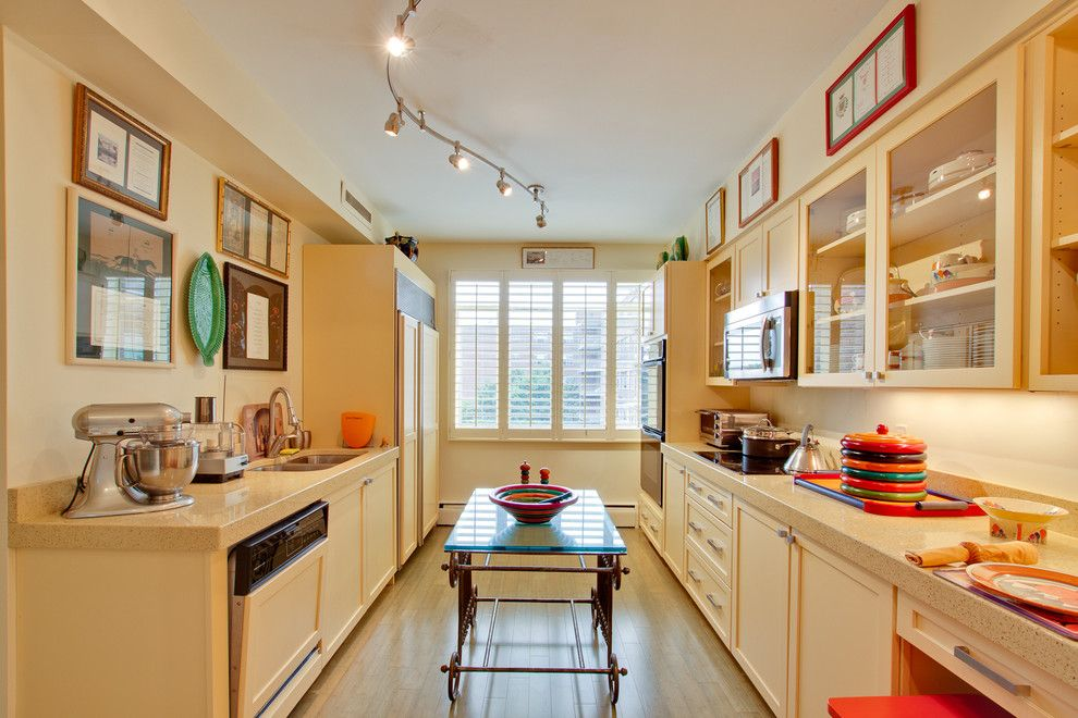 Icestone for a Eclectic Kitchen with a Artwork and Modern Transitional Buttermilk Yellow Kitchen by Reico Kitchen & Bath