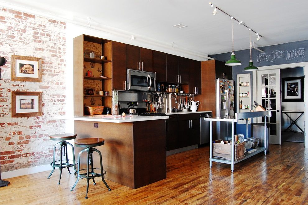 Icestone for a Industrial Kitchen with a Flat Panel Cabinets and My Houzz: Textiles Charm an Open Brooklyn Loft by Corynne Pless