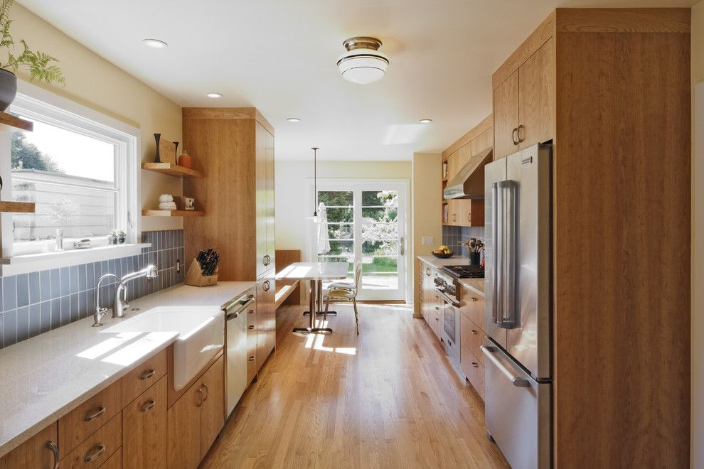 Icestone for a Transitional Kitchen with a Breakfast Nook and Wilshire Kitchen, Portland (Photo: Matt Niebuhr) by Howells Architecture + Design, Llc