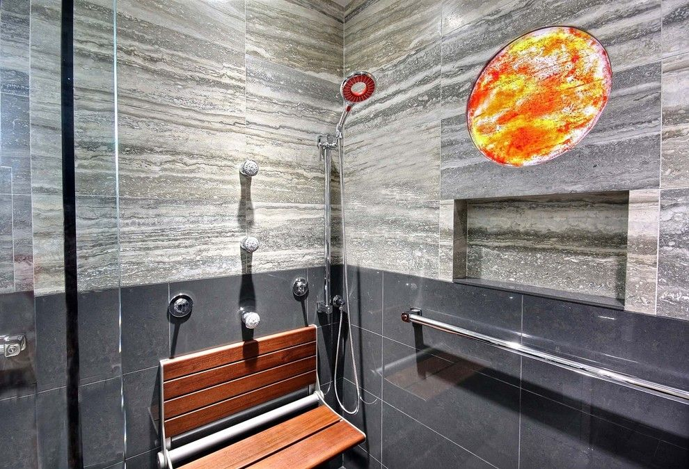 Icon at Dulles for a Modern Bathroom with a Grab Bars and Modern Spa Bath Designed for All Family Members to Comfortably Use by by Design Builders