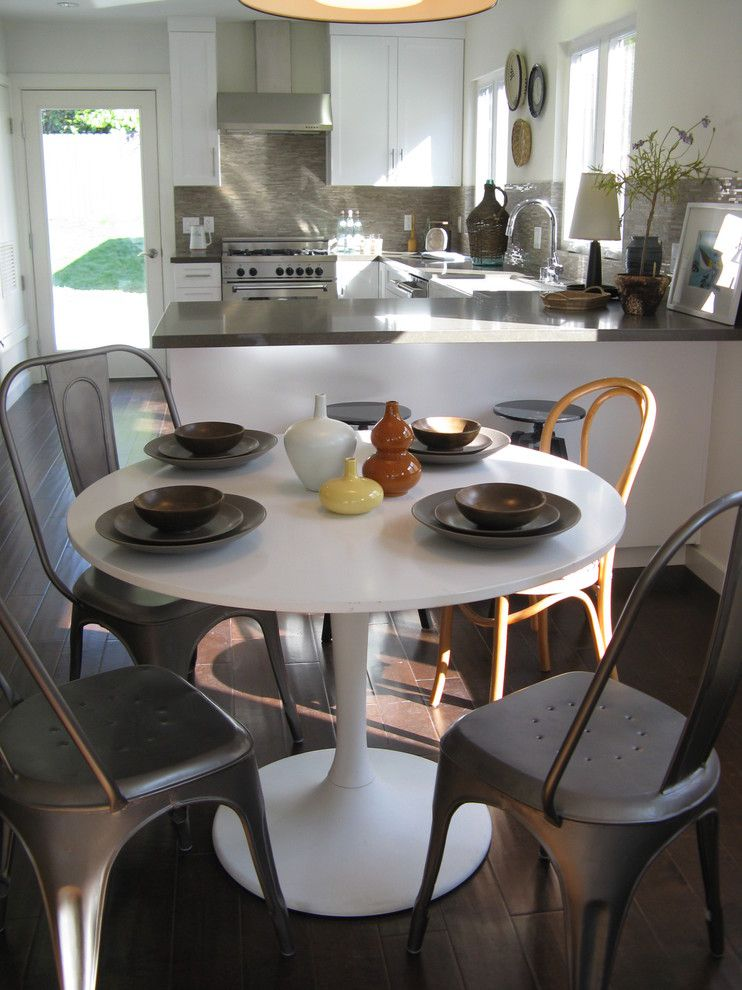 Ikea Bjursta Table for a Eclectic Dining Room with a Tile Backsplash and Saarinen Style Table by Madison Modern Home
