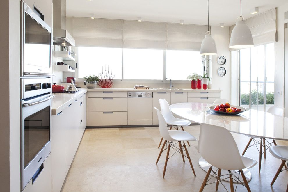 Ikea Bjursta Table for a Modern Kitchen with a White Pendant Lights and Photograper   Aviad Bar Ness, Architect   Karen Goor by Aviad Bar Ness