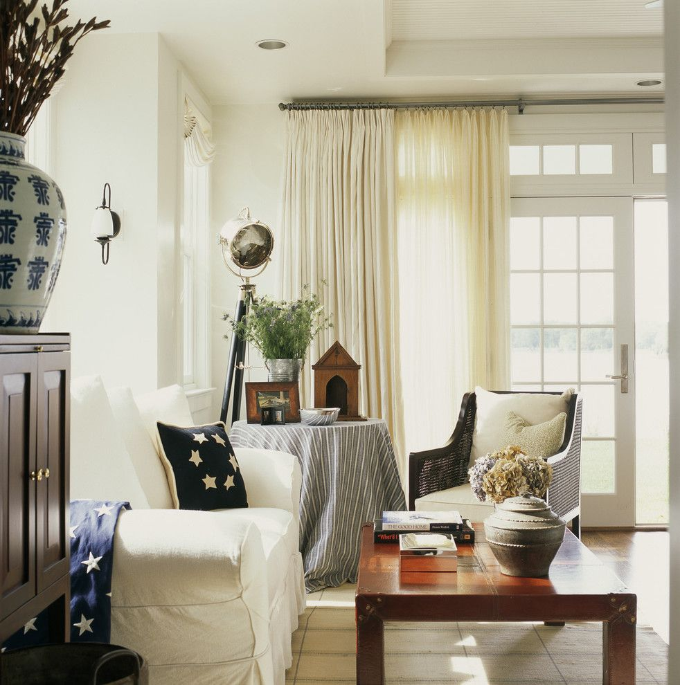 Ikea Curtain Rods for a Rustic Living Room with a Floral Arrangement and Easton House by Patrick Sutton Associates