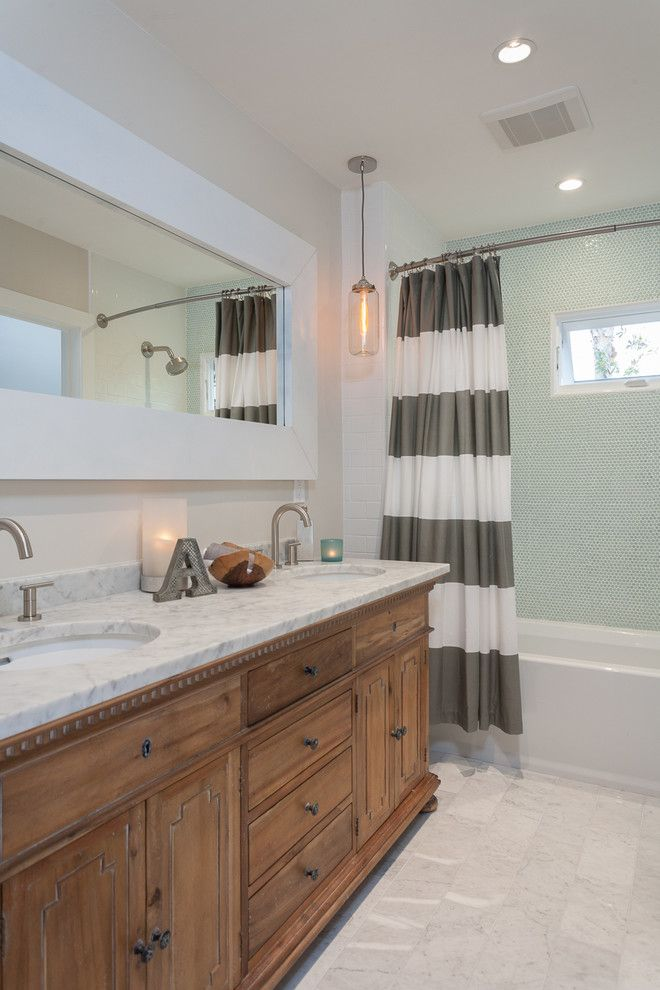 Ikea Curtain Rods for a Transitional Bathroom with a Tub and Balboa Coves Remodel by Eric Aust Architect