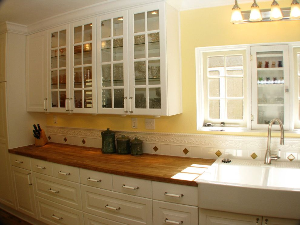 Ikea New Orleans for a  Kitchen with a Stacked Washer Dryer and Historic Ikea Kitchen by Homework Remodels ~ Tri-Lite Builders