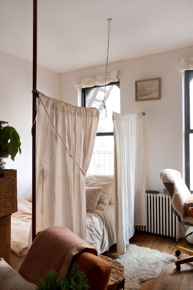 Ikea Panel Curtains for a Shabby Chic Style Bedroom with a Medium Hardwood Floor and My Houzz: Willa Kammerer by Rikki Snyder