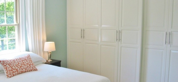 Ikea Panel Curtains for a Traditional Bedroom with a Wood Floor and Niesz Vintage by Kimberly Niesz