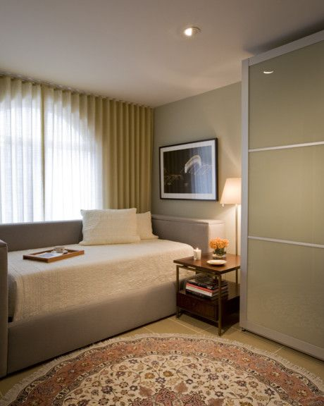 Ikea Pax Wardrobe for a Contemporary Bedroom with a Round Rug and Custom Daybed for Tempurpedic Adjustable Mattress by Ernesto Santalla Pllc