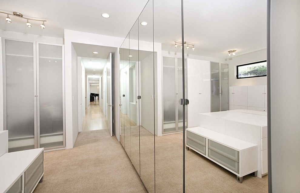 Ikea Pax Wardrobe for a Contemporary Closet with a Ceiling Lighting and Dressing Room by Mark English Architects, Aia