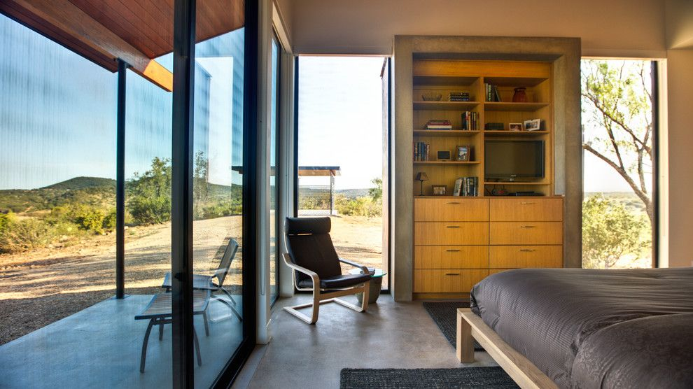 Ikea Poang for a Contemporary Bedroom with a Concrete Wall and Llano Bunk House by Jon Luce Builder