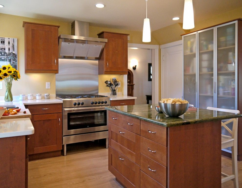 Ikea Quartz Countertops for a Contemporary Kitchen with a Wood Cabinets and A&e Tv Makeover by Cw Design, Llc