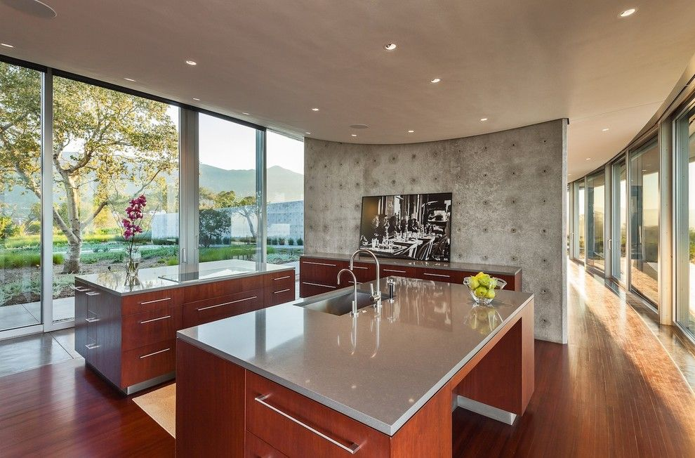 Ikea Quartz Countertops for a Modern Kitchen with a Wood Floor and Kurth Residence by Neumann Mendro Andrulaitis Architects Llp