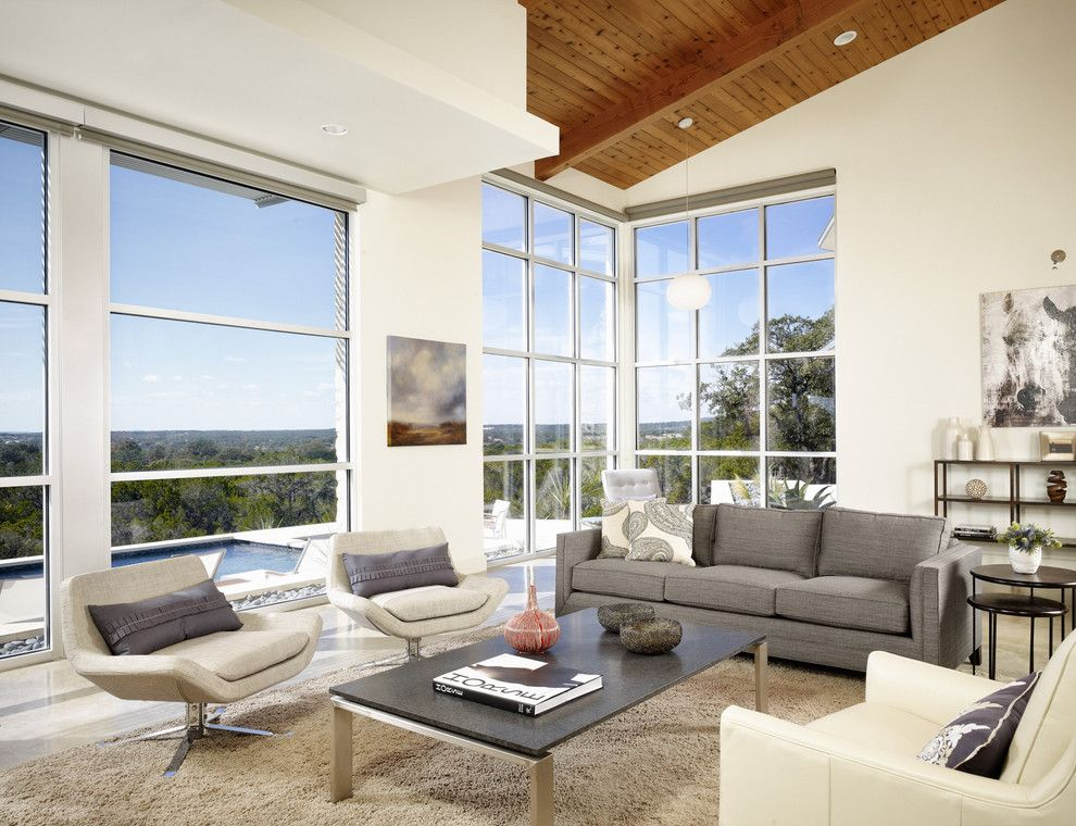 Ikea Swivel Chair for a Modern Living Room with a Wood Ceiling and Wimbereley Retreat by 3 Fold Design Studio