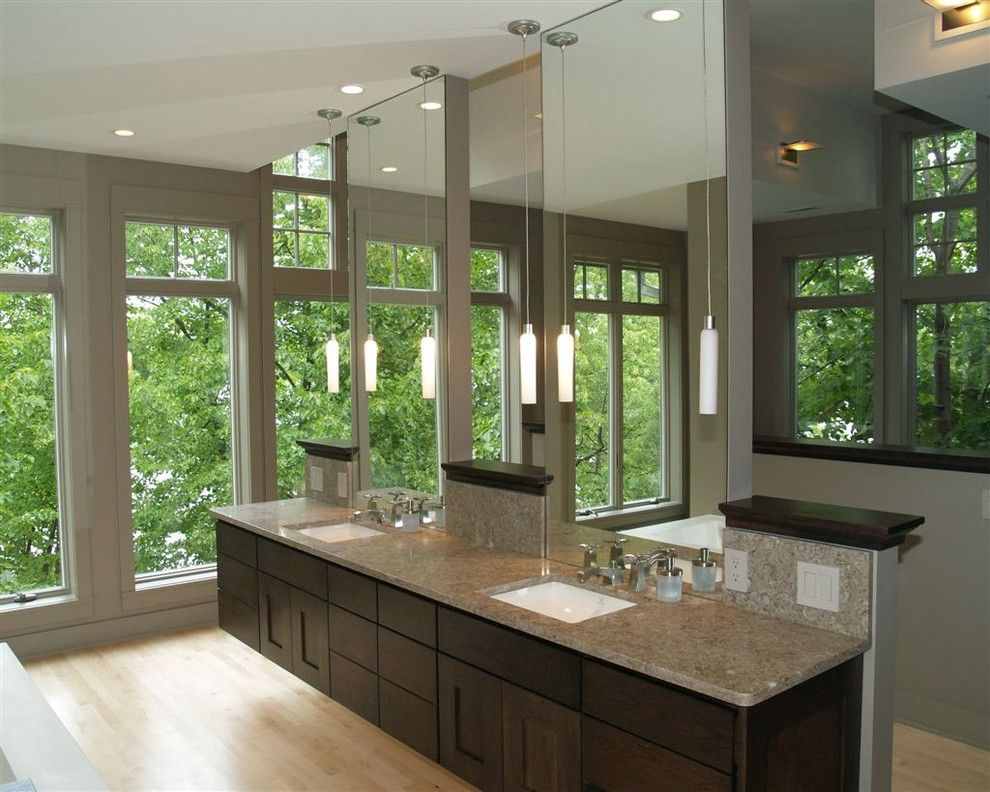 Illuminations Lighting for a Contemporary Bathroom with a Pendant Light and 2007 'Milwaukee Home and Fine Living' Best of Competition Award Winner by Architectural Homes by Anders Inc
