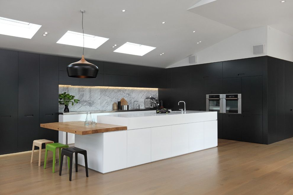 Illuminations Lighting for a Contemporary Kitchen with a Wood Flooring and Masons Ave Kitchen by Jessop  Architects