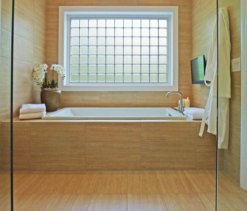 Indiana Limestone for a Contemporary Bathroom with a Bath Television and Albany Bathroom Designs by Hudson Valley Design