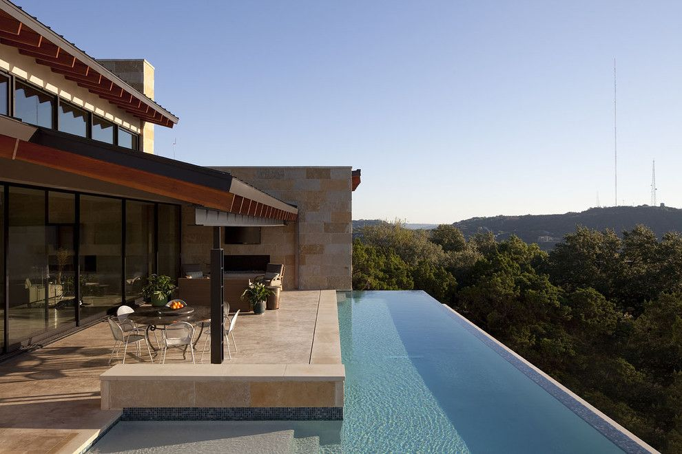 Infinity Edge Pool for a Contemporary Pool with a Hillside and Custom Pool and Spa by Dick Clark + Associates