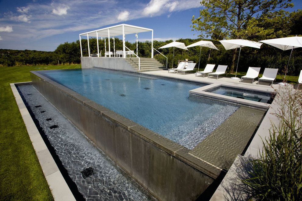 Infinity Edge Pool for a Contemporary Pool with a Riveria Marbledust and Infinity Edge Negative Edge Rimless Pools by J. Tortorella Swimming Pools