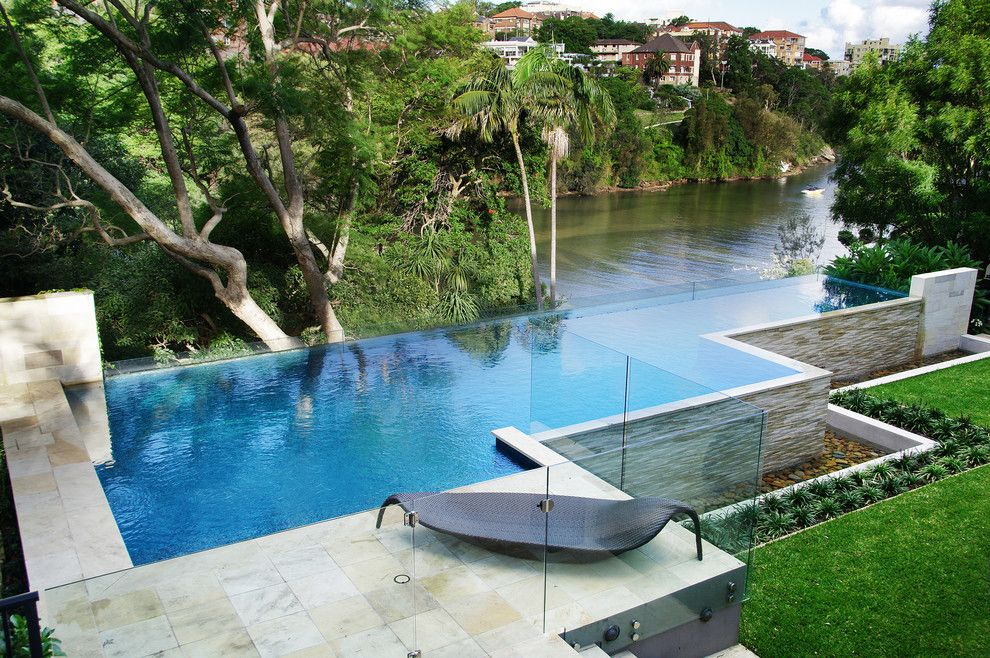 Infinity Edge Pool for a Contemporary Pool with a Trees and Shellcove by Peter Glass & Associates