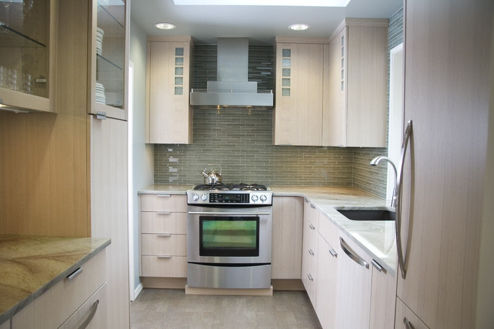 Installing Backsplash for a Contemporary Kitchen with a Panel Refrigerator and Small Contemporary Kitchen by Robin Rigby Fisher Cmkbd/caps