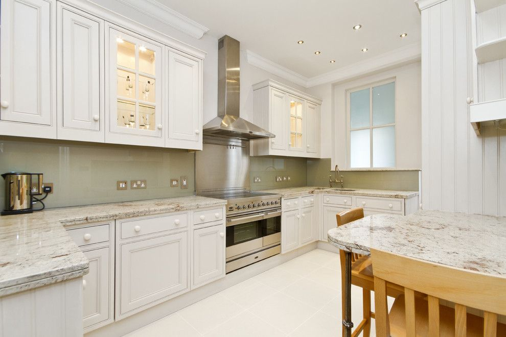 Installing Backsplash for a Transitional Kitchen with a White Wood and Knight Frank Ltd by Chris Snook