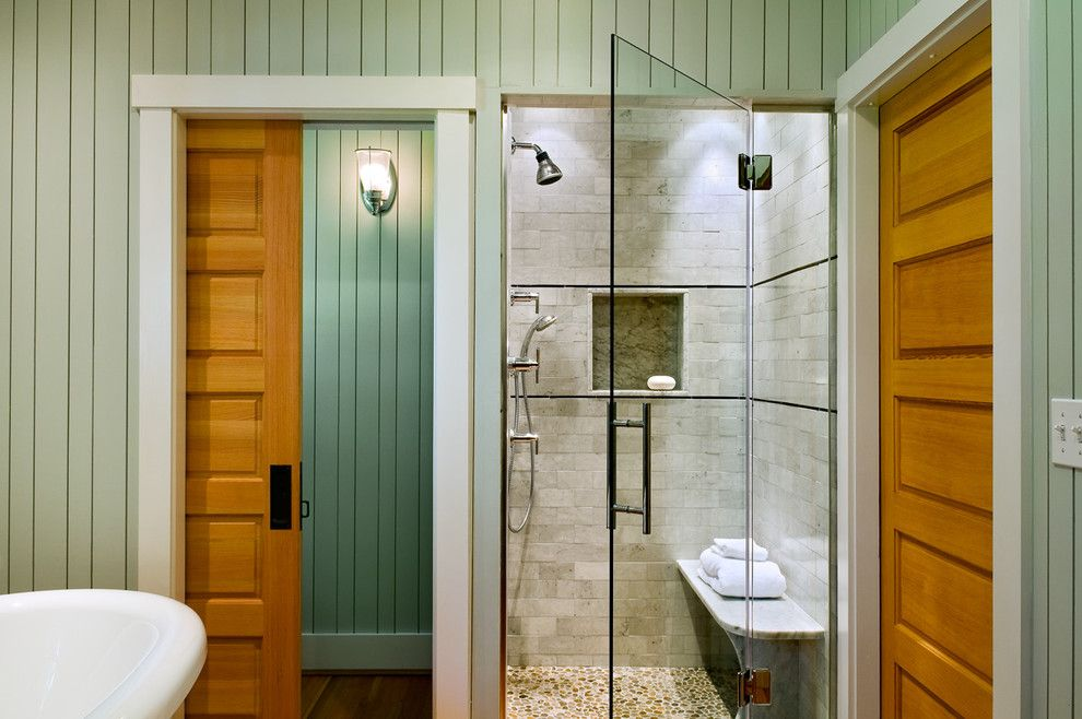 Installing Pocket Doors for a Beach Style Bathroom with a Wood Molding and Bathroom by Whitten Architects
