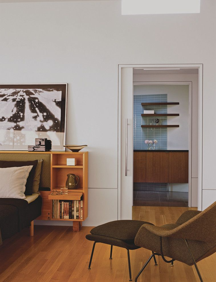 Installing Pocket Doors for a Midcentury Bedroom with a Wood Flooring and Master Bedroom by Laidlaw Schultz Architects