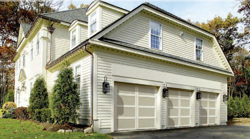 Installing Pocket Doors for a Traditional Garage with a Garage Doors Openers and Carriage House by Overhead Door Company of Albany