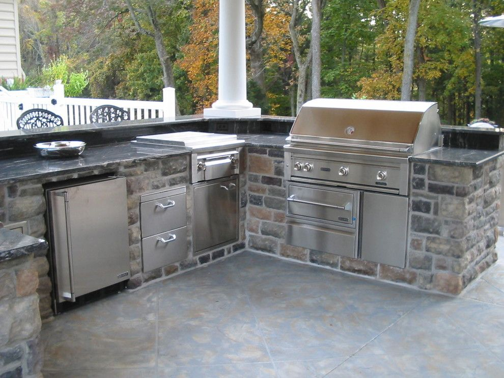 Ionic Columns for a Contemporary Patio with a Backyard Barbecue and Lynx Grills by Lynx Grills, Inc.