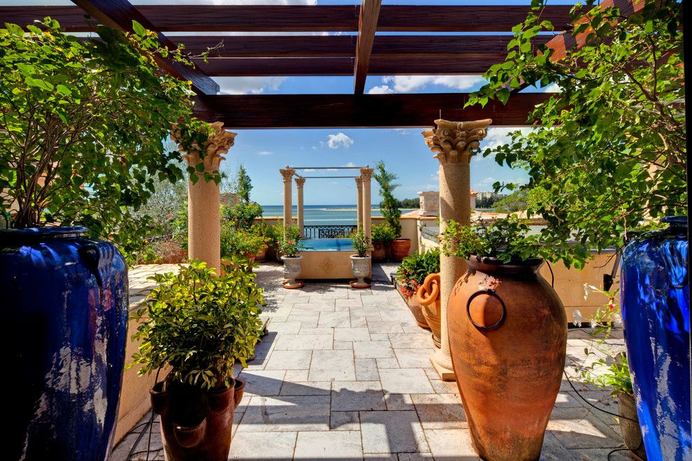 Ionic Columns for a Mediterranean Patio with a Corinthian Columns and 4011 Higel Siesta Key by Perrone Construction Custom Homes