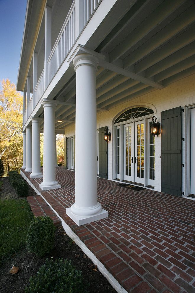 Ionic Columns for a Traditional Exterior with a French Colonial and French Colonial Residence by Jonathan Miller Architects