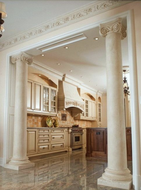 Ionic Columns for a Traditional Kitchen with a Cast Stone Columns and Ionic Marble Columns in Kitchen by Marvelous Marble Design Inc.