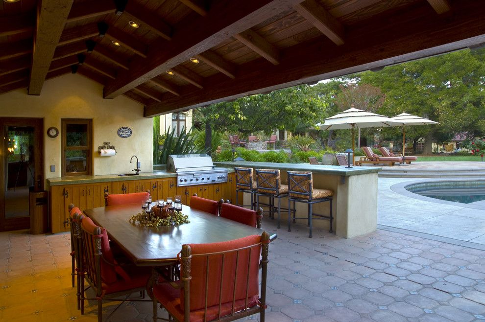 Islander Pools for a Mediterranean Patio with a Pool Deck and Saratoga Estate by Kikuchi + Kankel Design Group