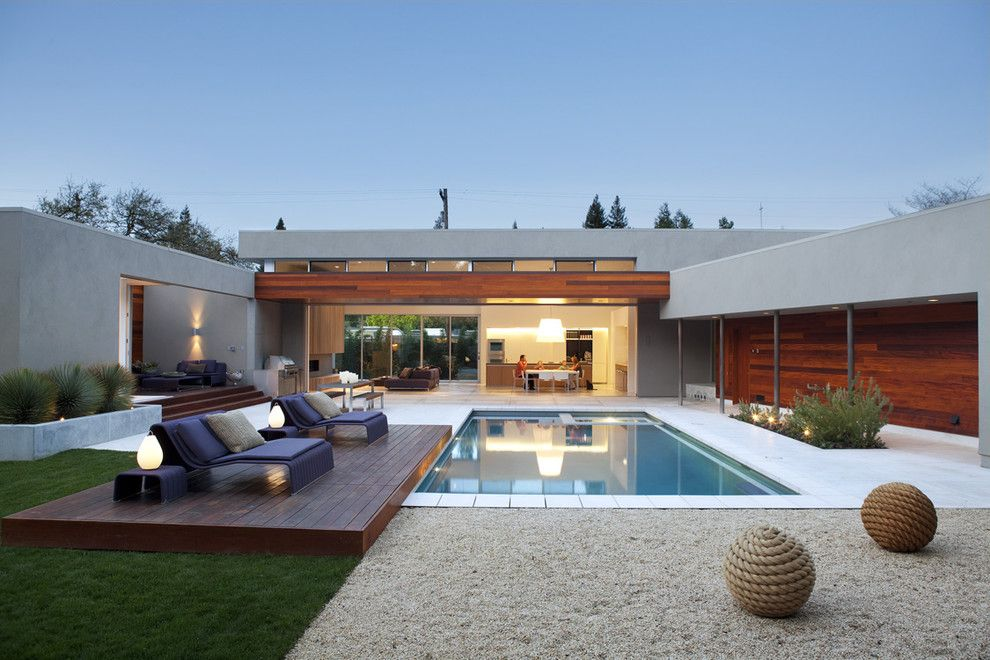 Islander Pools for a Modern Pool with a Steps and Outdoor Living by Dumican Mosey Architects