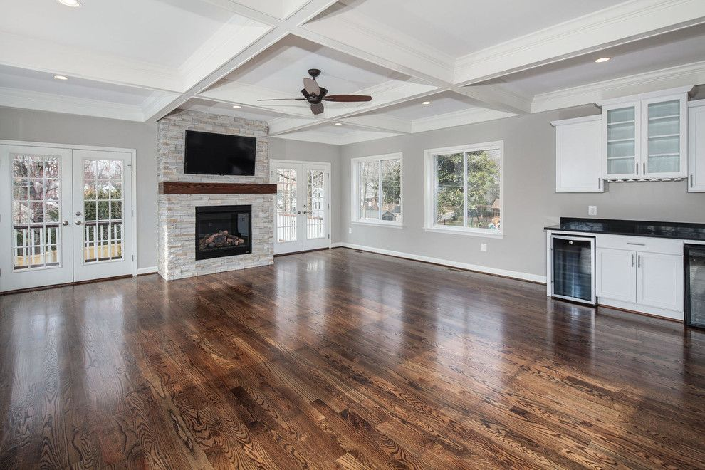 Jacobean Stain for a Transitional Family Room with a Walls Painted Gray and Contemporary Custom Home, Family Room by Classic Cottages Llc