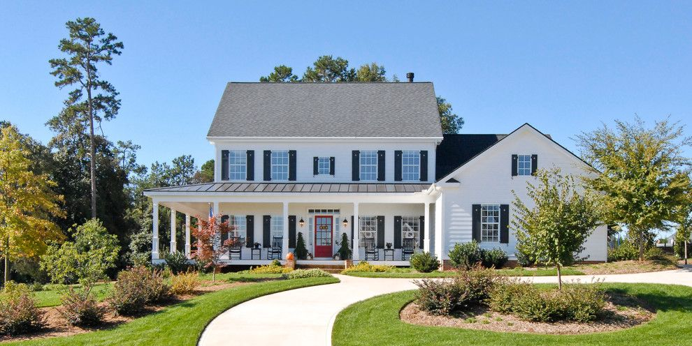 James Hardie Building Products for a Farmhouse Exterior with a Covered Porch and Farm House by Bergeron Custom Homes, Llc