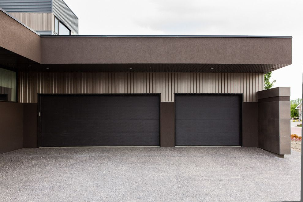 Jen Weld Doors for a Modern Garage with a Earth Tone Colors and Wolf in the Willows by Habitat Studio