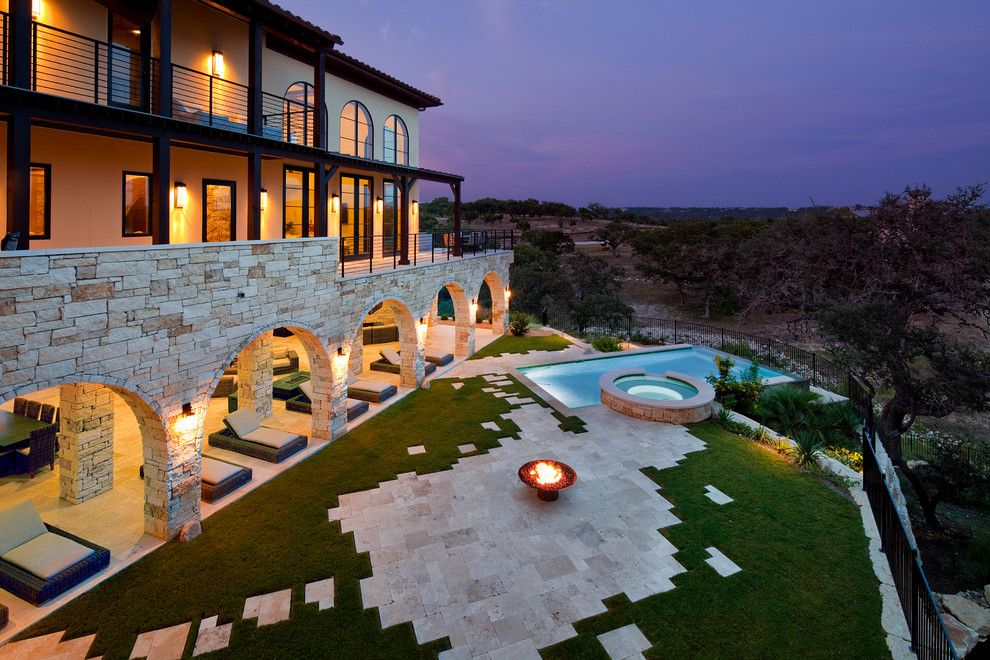 Jenkins Brick for a Mediterranean Landscape with a Outdoor Chaise Lounge and Flood Plain Home on Lake Travis Outdoor Living by Jenkins Custom Homes