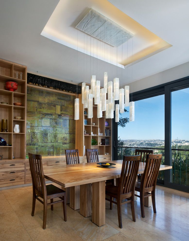 Jesco lighting for a contemporary dining room with a wood dining chairs and shakúff by shakuff