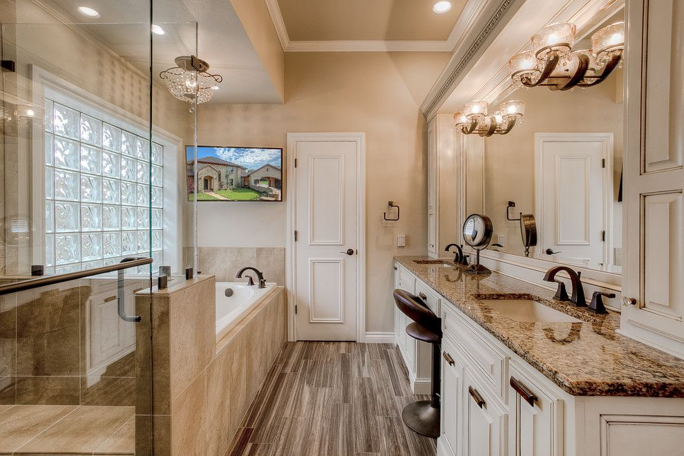 Jetta Tubs for a Traditional Bathroom with a Crystal Ceiling Light and Master Bath Remodel by Clayburn Development and Pools