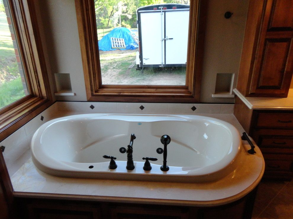 Jetta Tubs for a Traditional Bathroom with a Marble Tub Deck and Master Suite Addition by Birmingham Remodeling and Construction