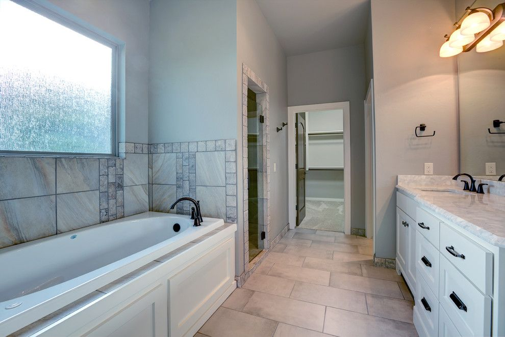 Jetta Tubs for a Transitional Bathroom with a Shower and Spring Parade of Homes 2015 by Adams Kirby Homes