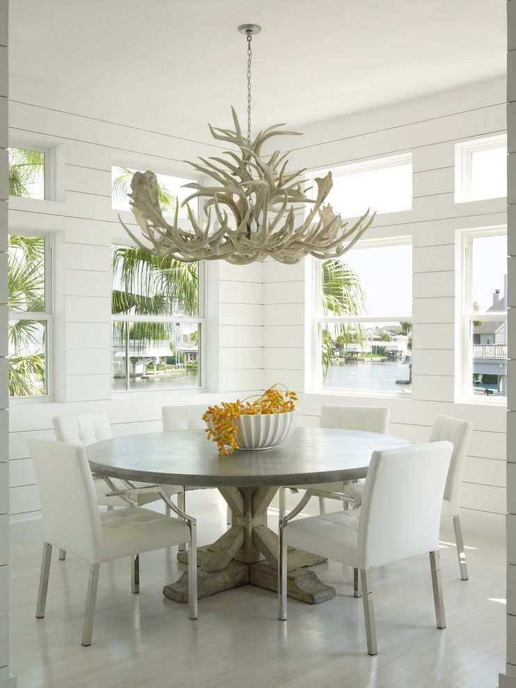 John Houston Custom Homes for a Beach Style Dining Room with a Transom Windows and Luxe Galveston Project by Laura C. Singleton Interiors
