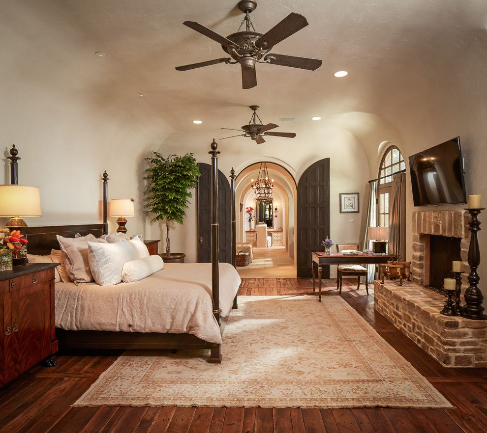 john houston custom homes for a mediterranean bedroom with a wall mounted tv and bordley by
