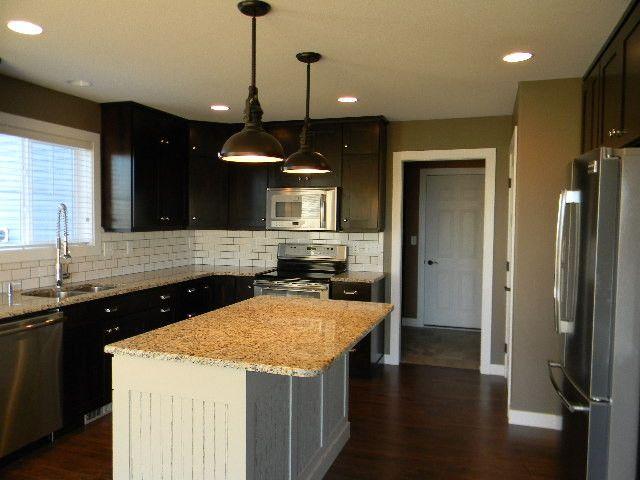 Jordahl Custom Homes for a Contemporary Kitchen with a Kitchen and Kitchens by Jordahl Custom Homes