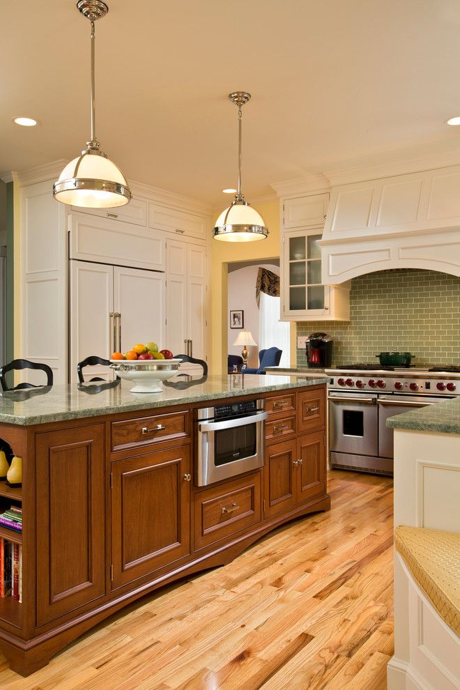 Jsi Cabinetry for a Traditional Kitchen with a Green Mosaic and Spring Kitchen by Teakwood Builders, Inc.