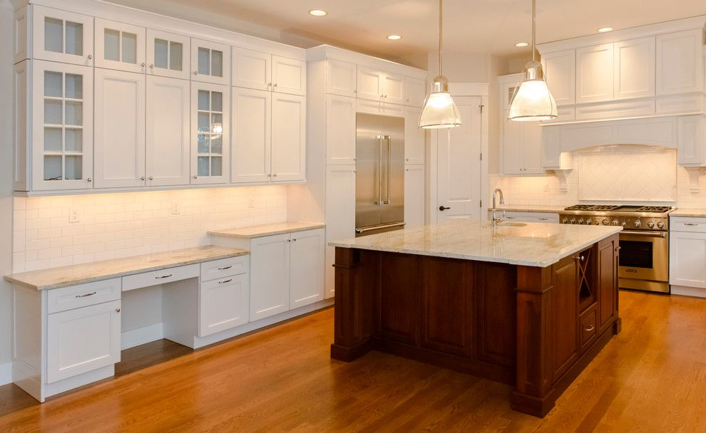 Kam Appliance for a Traditional Kitchen with a Moen and Wellstone Place by the Lewes Building Company