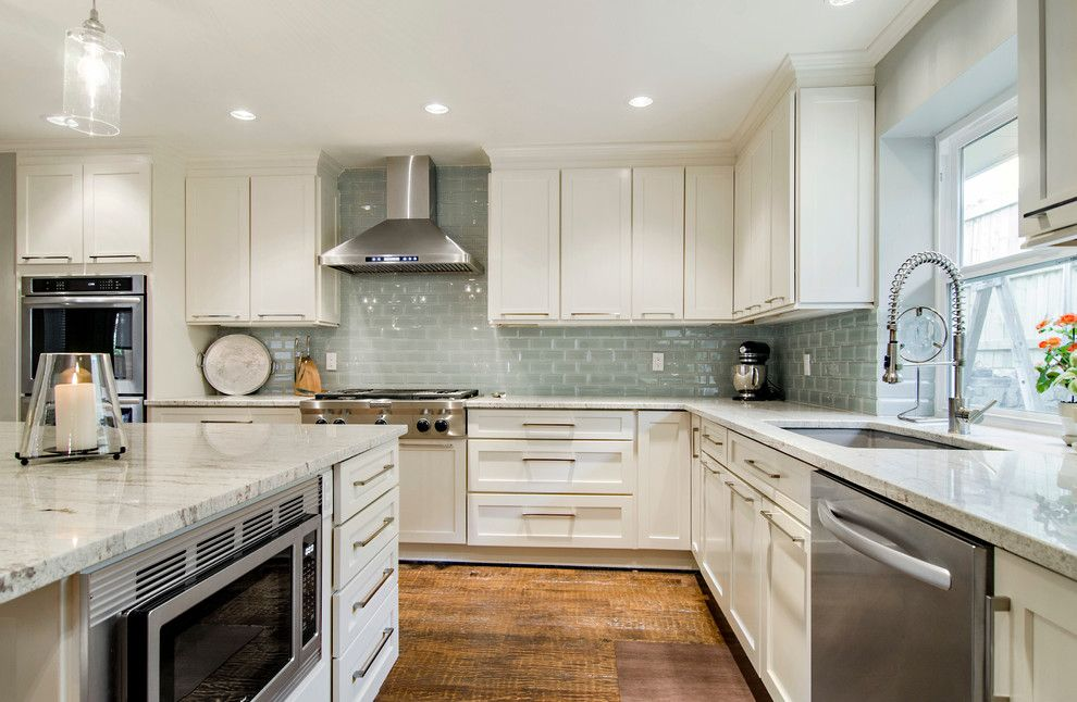 Kashmir White Granite for a Transitional Kitchen with a Beveled Glass and Looking at the Range Wall by Hatfield Builders & Remodelers